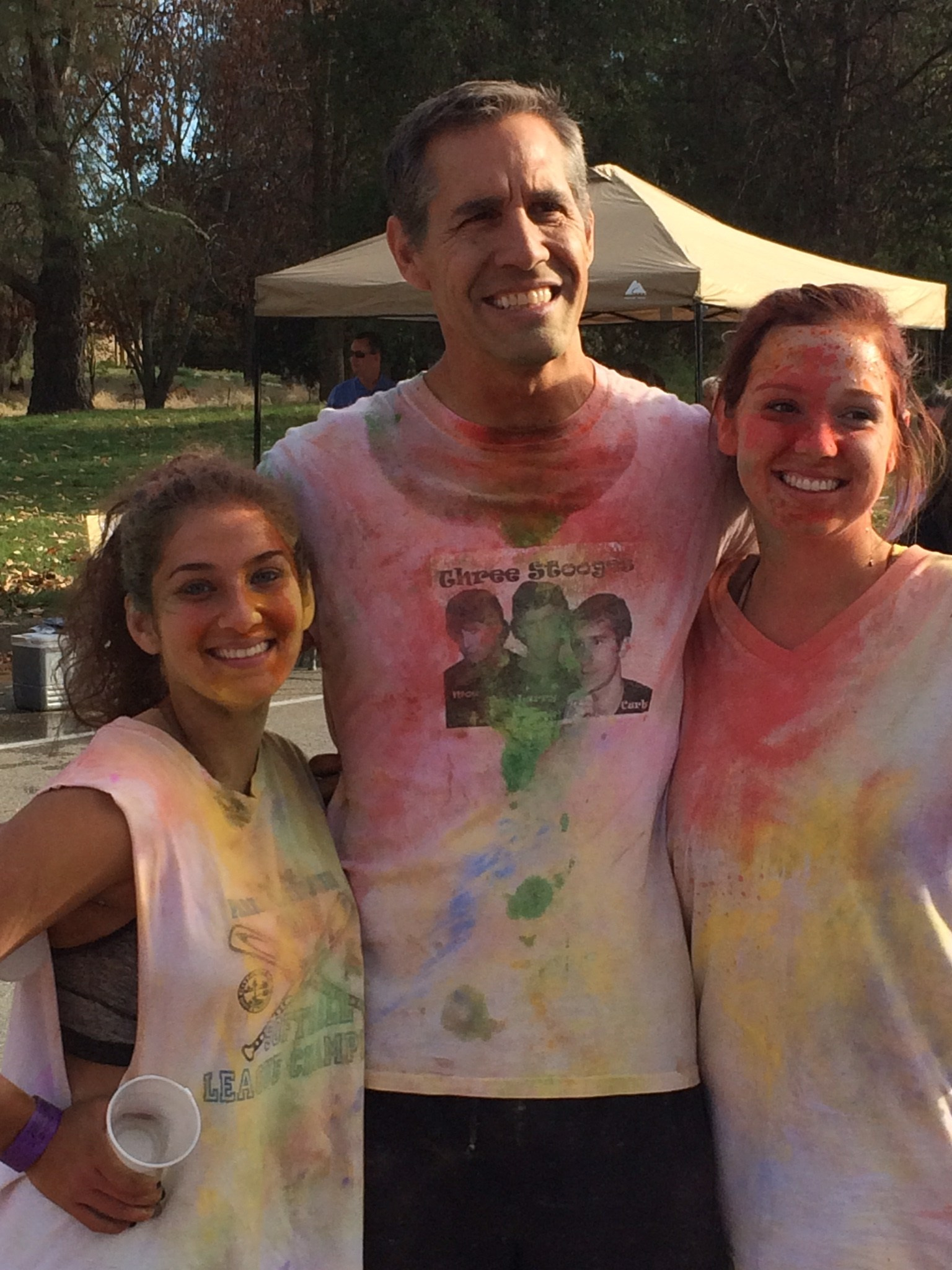 people covered in colored chalk